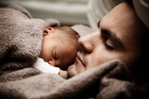 father-sleeping-with-his-baby-son