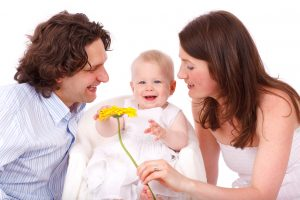 happy-family-with-baby-daughter-and-yellow-flower