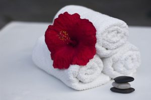 towel-and-red-flower-in-spa